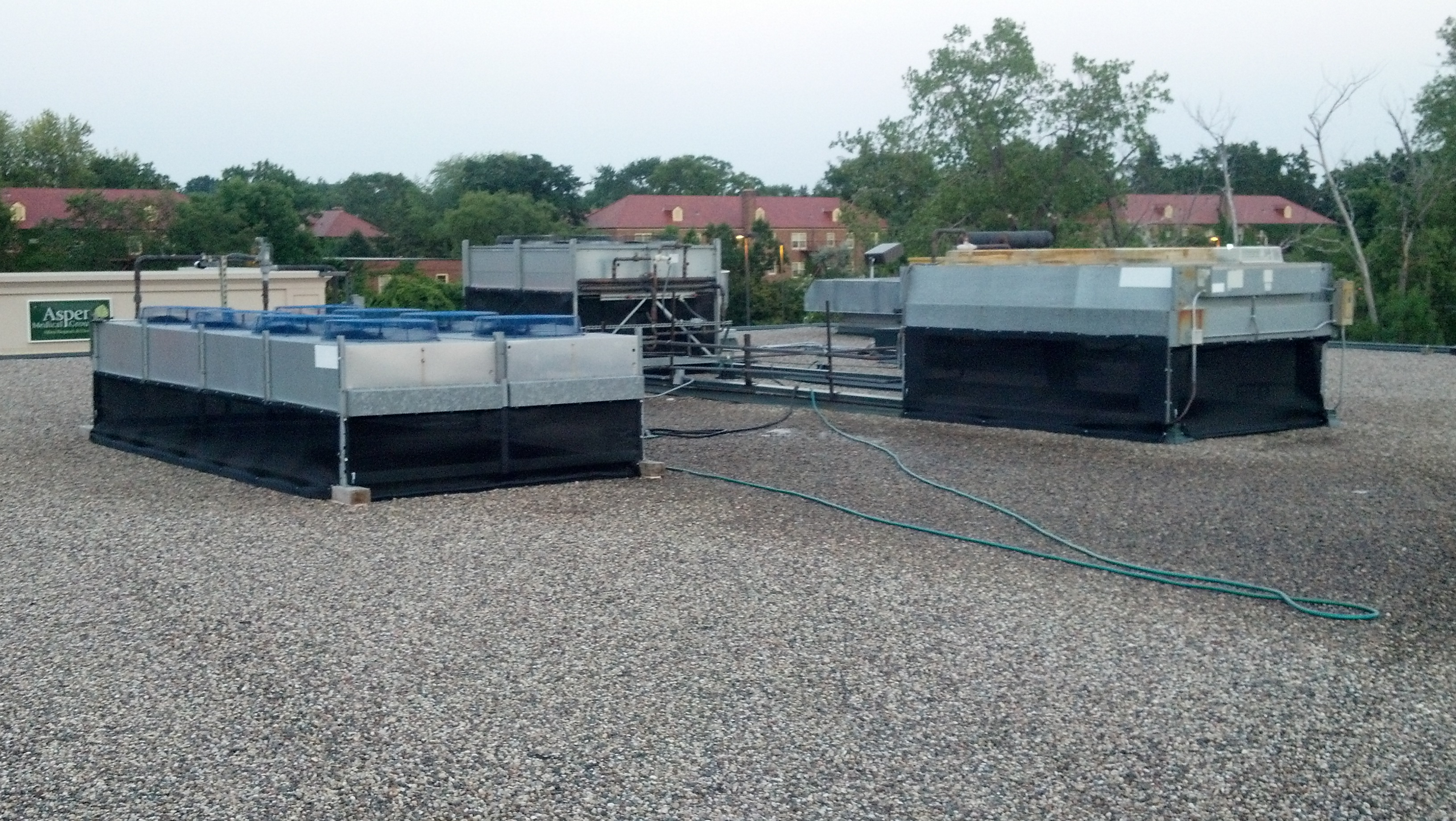 Cottonwood Screens Protect Refrigerated Case Condenser
