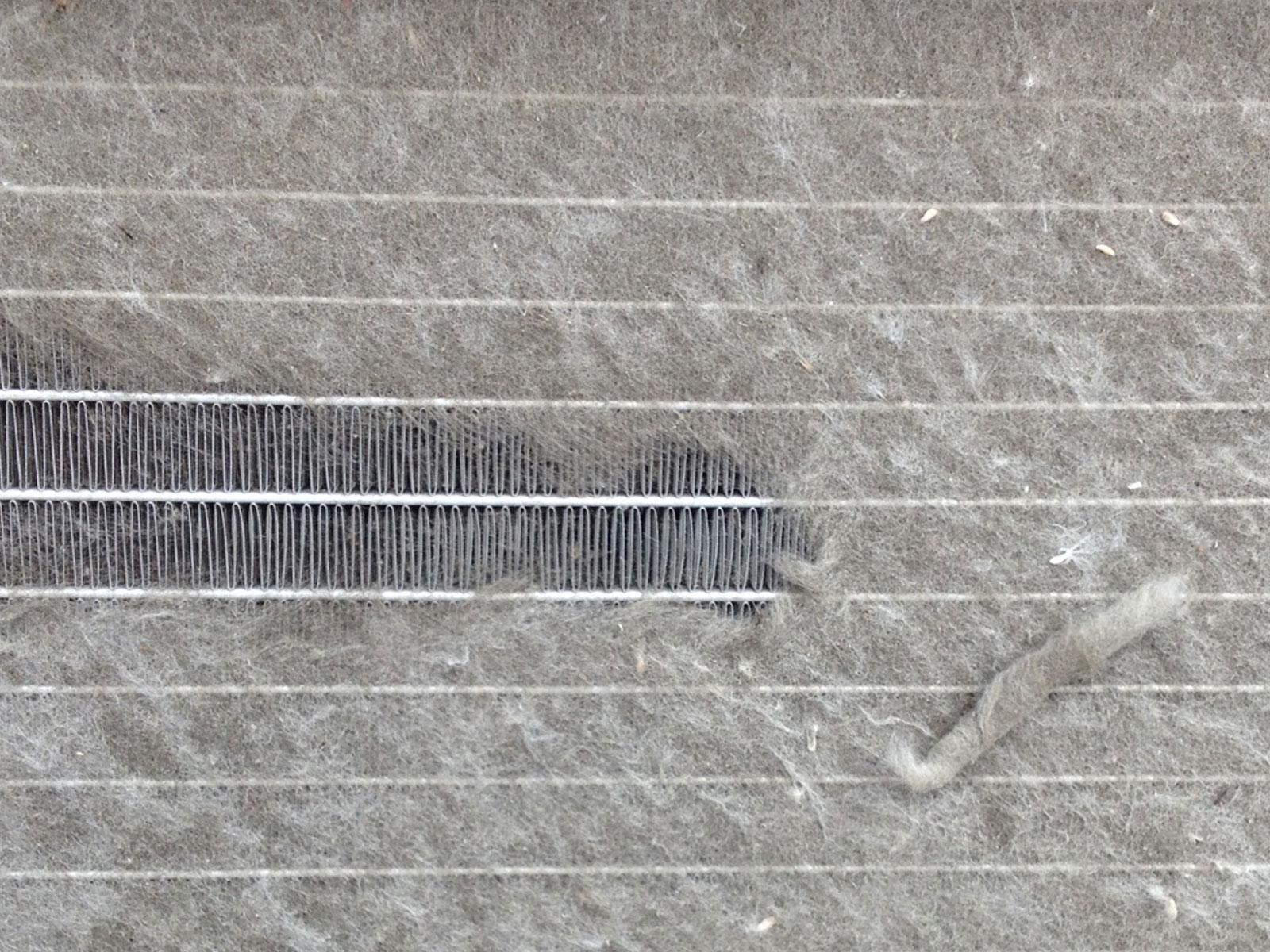 Clogged Coil Fins Restrict Critical Air Flow